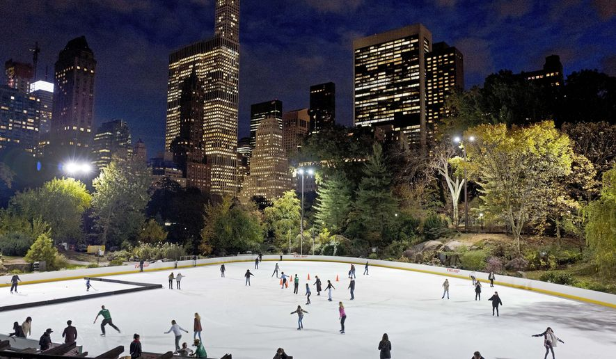 In this Nov. 3, 2016 file photo, skaters take to the ice at Wollman Rink in New York's Central Park. New York City will terminate business contracts with President Donald Trump after last week's insurrection at the U.S. Capitol, Mayor Bill de Blasio announced Wednesday, Jan. 13, 2021. The Trump Organization is under city contract to operate the two ice rinks and a carousel in Central Park as well as a golf course in the Bronx. (AP Photo/Mark Lennihan, File)