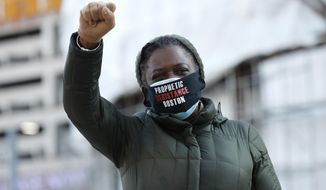 Tenants' rights advocate Danielle Willams demonstrates outside the Edward W. Brooke Courthouse, Wednesday, Jan. 13, 2021, in Boston. The protest was part of a national day of action calling on the incoming Biden administration to extend the eviction moratorium initiated in response to the Covid-19 pandemic. (AP Photo/Michael Dwyer)