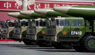 China's DF-26 ballistic missiles worry the U.S. because they can be fired from long ranges with enough precision to attack a moving ship. (Associated Press)