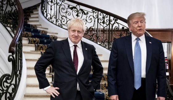 In this Sunday, Aug. 25, 2019, file photo, President Donald Trump and Britain's Prime Minister Boris Johnson, left, speak to the media before a working breakfast meeting at the Hotel du Palais on the sidelines of the G-7 summit in Biarritz, France. (Erin Schaff, Pool via AP) ** FILE **
