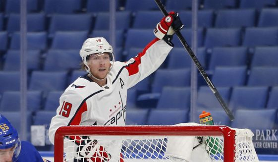Washington Capitals forward Nicklas Backstrom (19) celebrates his goal during the first period of an NHL hockey game against the Buffalo Sabres, Thursday, Jan. 14, 2021, in Buffalo, N.Y. (AP Photo/Jeffrey T. Barnes)