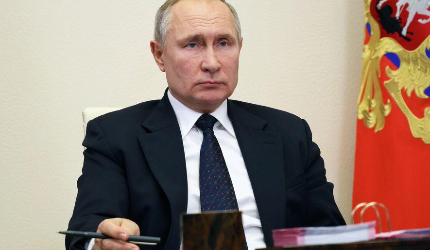 Russian President Vladimir Putin attends a meeting via video conference at the Novo-Ogaryovo residence outside Moscow Moscow, Russia, Thursday, Jan. 14, 2021. (Mikhail Klimentyev, Sputnik, Kremlin Pool Photo via AP)