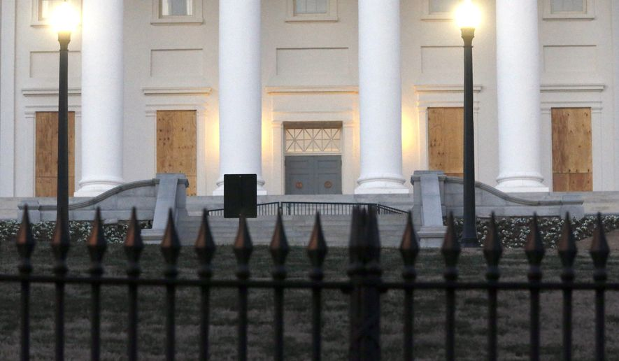 First floor windows were boarded up on the State Capitol in Richmond, Va., Thursday, Jan. 14, 2021. The precautions are due to planned rallies over the next few days. (Bob Brown/Richmond Times-Dispatch via AP)