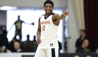 FILE - Then-Hargrave Military Academy's K.D. Johnson gestures during a high school basketball game against Orangeville Prep at the Hoophall Classic in Springfield, Mass., in this Sunday, Jan. 19, 2020, file photo. Georgia, winless in conference action, added a much-needed midseason boost with the addition of Johnson, adding a top recruit and hope for a turnaround.  (AP Photo/Gregory Payan, File)