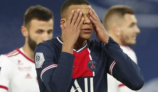 PSG's Kylian Mbappe reacts after missing a chance during the French League One soccer match between Paris Saint-Germain and Brest at the Parc des Princes in Paris, Saturday, Jan. 9, 2021. (AP Photo/Francois Mori)