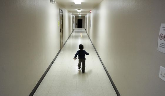 In this Dec. 11, 2018, photo, an asylum-seeking boy from Central America runs down a hallway after arriving from an immigration detention center to a shelter in San Diego. A court-appointed committee has yet to find the parents of 628 children separated at the border early in the Trump administration. (AP Photo/Gregory Bull) **FILE**