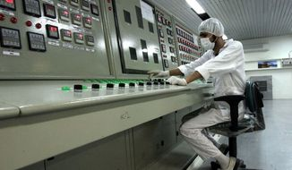 In this Feb. 3, 2007 file photo, a technician works at the Uranium Conversion Facility just outside the city of Isfahan, Iran, 255 miles (410 kilometers) south of the capital Tehran.  (AP Photo/Vahid Salemi, File)   **FILE**