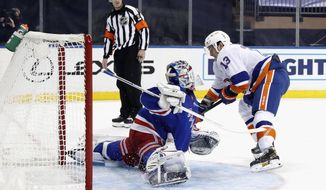 New York Rangers goalie Igor Shesterkin makes a save against New York Islanders' Mathew Barzal during the third period of an NHL hockey game Thursday, Jan. 14, 2021, in New York. (Bruce Bennett/Pool Photo via AP)