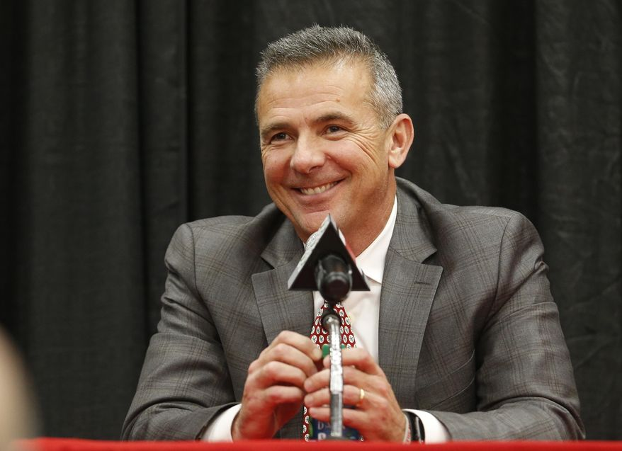 Ohio State NCAA college football head coach Urban Meyer answers questions during a news conference announcing his retirement in Columbus, Ohio, in this Tuesday, Dec. 4, 2018, file photo. A person familiar with the search says Urban Meyer and the Jacksonville Jaguars are working toward finalizing a deal to make him the team's next head coach. The person spoke to The Associated Press on the condition of anonymity Thursday, Jan. 14, 2021, because a formal agreement was not yet in place. (AP Photo/Jay LaPrete, File) **FILE**