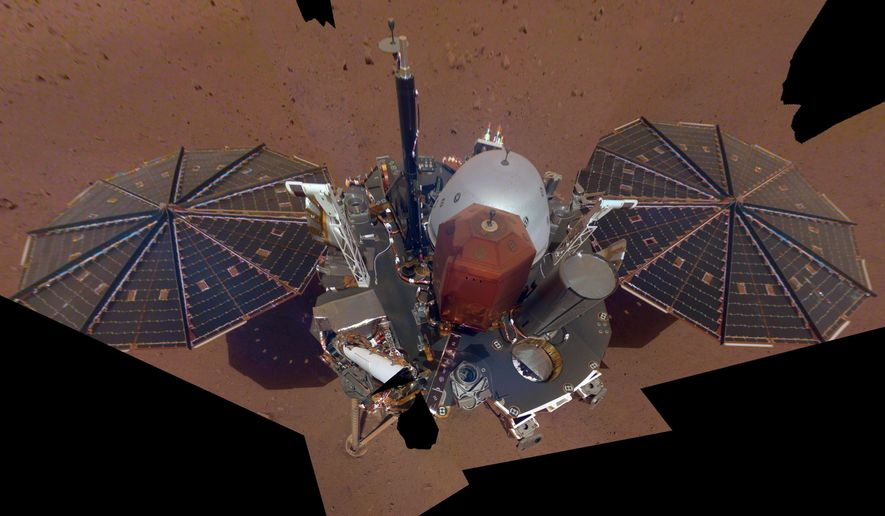 FILE - This Dec. 6, 2018 image made available by NASA shows the InSight lander. The scene was assembled from 11 photos taken using its robotic arm. On Thursday, Jan. 14, 2021, NASA declared the craft dead after failing to burrow deep into the red planet to take its temperature. (NASA via AP)