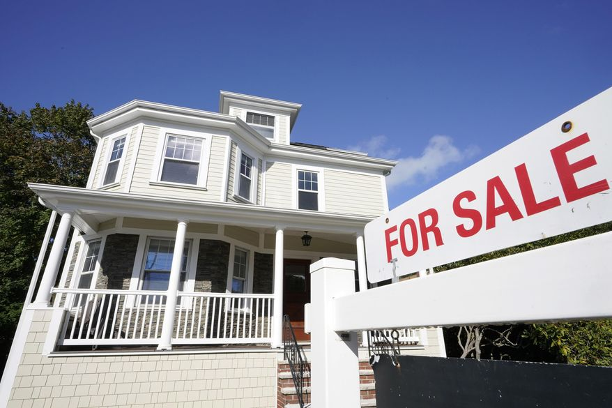 A for sale sign stands in front of a house, Tuesday, Oct. 6, 2020, in Westwood, Mass., in this file photo. (AP Photo/Steven Senne, File)  **FILE**