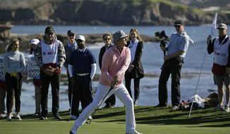 FILE - In this Wednesday, Feb. 5, 2020, file photo, Bill Murray tosses his putter into a bunker after missing a birdie putt on the 18th green of the Pebble Beach Golf Links during the celebrity challenge event of the AT&T Pebble Beach National Pro-Am golf tournament, in Pebble Beach, Calif. Celebrities will not be part of the tournament this year because of the spike in COVID-19 cases. (AP Photo/Eric Risberg, File)