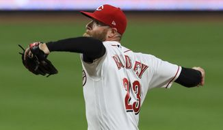 FILE - In this Sept. 14, 2020, file photo, Cincinnati Reds' Archie Bradley throws during the team's baseball game against the Pittsburgh Pirates in Cincinnati. The Philadelphia Phillies and Bradley have agreed on a $6 million, one-year contract, according to a person familiar with the deal. The person spoke to The Associated Press on condition of anonymity Thursday night, Jan. 14, 20201, because the agreement is pending a successful physical. (AP Photo/Aaron Doster, File)