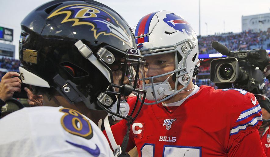 Buffalo Bills quarterback Josh Allen (17) talks with Baltimore Ravens quarterback Lamar Jackson (8) following a 24-17 Ravens win in an NFL football game in Orchard Park, N.Y., in this Sunday, Dec. 8, 2019, file photo. Buffalo's Josh Allen and Baltimore's Lamar Jackson become the first quarterbacks of the five-member 2018 first-round draft class set to meet in the playoffs as the Bills prepare to face the Ravens in the AFC divisional round on Saturday night, Jan. 16, 2021. (AP Photo/John Munson, File) **FILE**