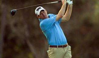 Jim Herman follows through on his shot from the first tee box during the first round of the Sony Open golf tournament Thursday, Jan. 14, 2021, at Waialae Country Club in Honolulu. (AP Photo/Jamm Aquino)