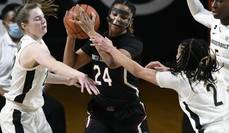 South Carolina guard LeLe Grissett (24) protects the ball from Vanderbilt's Brylee Bartram, left, and Chelsie Hall (2) after grabbing a rebound during the first half of an NCAA college basketball game Thursday, Jan. 14, 2021, in Nashville, Tenn. (AP Photo/Mark Zaleski)