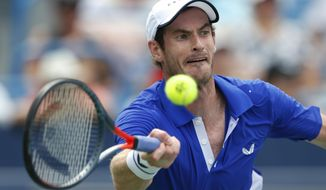 FILE - In this Monday, Aug. 12, 2019 file photo Andy Murray, of Britain, hits a forehand against Richard Gasquet, of France, during first-round play at the Western & Southern Open tennis tournament, in Mason, Ohio. Former world number one Murray's participation at the upcoming Australian Open is in doubt after the Briton tested positive for COVID-19. (AP Photo/Gary Landers, File)
