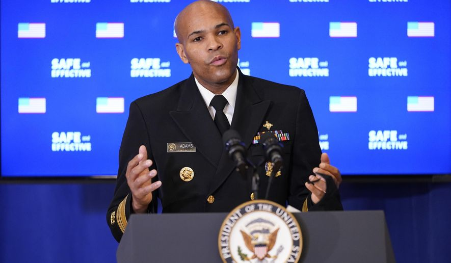 U.S. Surgeon General Jerome Adams speaks after receiving a Pfizer-BioNTech COVID-19 vaccine shot at the Eisenhower Executive Office Building on the White House complex, Friday, Dec. 18, 2020, in Washington.  Vice President Mike Pence, his wife Karen Pence, also received shots.  (AP Photo/Andrew Harnik)