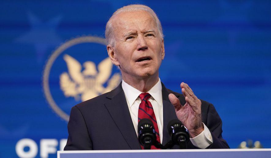 President-elect Joe Biden speaks during an event at The Queen theater, Friday, Jan. 15, 2021, in Wilmington, Del. (AP Photo/Matt Slocum)
