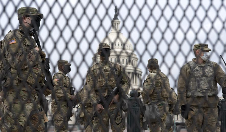 Members of the National Guard stand outside the U.S. Capitol in Washington Friday, Jan. 15, 2021. (AP Photo/Jose Luis Magana) ** FILE **