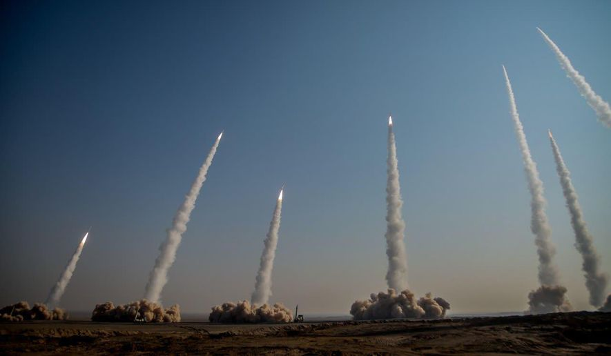 In this photo released on Friday, Jan. 15, 2021, by the Iranian Revolutionary Guard, missiles are launched in a drill in Iran. Iran's paramilitary Revolutionary Guard forces on Friday held a military exercise involving ballistic missiles and drones in the country's central desert, state TV reported, amid heightened tensions over Tehran's nuclear program and a U.S. pressure campaign against the Islamic Republic. (Iranian Revolutionary Guard/Sepahnews via AP)