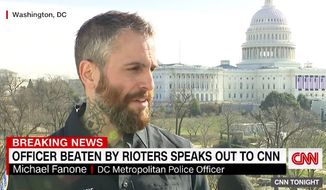 D.C. Metropolitan Police Officer Michael Fanone on Friday recalled getting beaten by a mob of angry Trump supporters during the Capitol riot last week, saying a smaller group eventually came to his rescue and protected him until help arrived. (Screengrab via CNN)  **FILE**