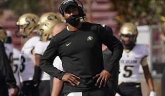 FILE -  In this Nov. 14, 2020, file photo, Colorado head coach Karl Dorrell stands on the sideline during the first half of an NCAA college football game against Stanford in Stanford, Calif. First-year Colorado coach Dorrell has the Buffaloes in a bowl for the first time since 2016. (AP Photo/Jeff Chiu, File)