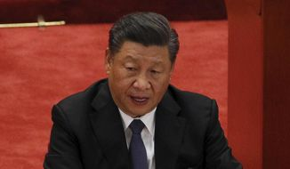 """Chinese President Xi Jinping had warned at the World Economic Forum last month that the U.S. risked starting a """"new Cold War"""" if they tried to rally the rest of the world against Beijing. (AP Photo/Andy Wong, File)"""