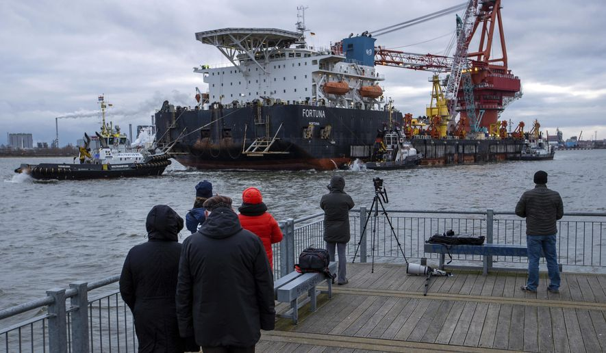 """Tugs pull the Russian pipe-laying vessel """"Fortuna"""" out of the harbor and into the Baltic Sea at the port of Wismar, Germany, Thursday, Jan 14, 2021. The special vessel is being used for construction work on the German-Russian Nord Stream 2 gas pipeline in the Baltic Sea. ( Jens Buettner/dpa via AP) ** FILE **"""
