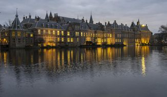 View of Binnenhof, the seat of the Dutch government in The Hague, Netherlands, Friday, Jan. 15, 2021, where the Cabinet was set to meet Friday amid strong speculation that Prime Minister Mark Rutte's government will resign to take political responsibility for a scandal involving child benefit investigations. (AP Photo/Mike Corder)