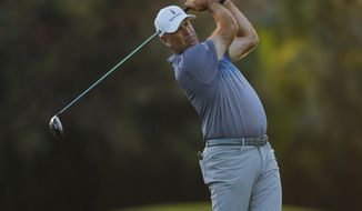 Stewart Cink follows his shot from the first tee box during the second round of the Sony Open golf tournament Friday, Jan. 15, 2021, at Waialae Country Club in Honolulu. (AP Photo/Jamm Aquino)
