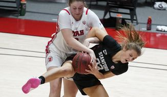 Utah forward Andrea Torres, rear, and Stanford guard Hannah Jump (33) battle for a rebound in the second half during an NCAA college basketball game Friday, Jan. 15, 2021, in Salt Lake City. (AP Photo/Rick Bowmer)