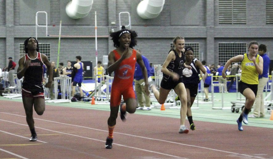 In this Feb. 7, 2019, file photo, Bloomfield High School transgender athlete Terry Miller, second from left, wins the final of the 55-meter dash over transgender athlete Andraya Yearwood, far left, and other runners in the Connecticut girls Class S indoor track meet at Hillhouse High School in New Haven, Conn. (AP Photo/Pat Eaton-Robb, File)