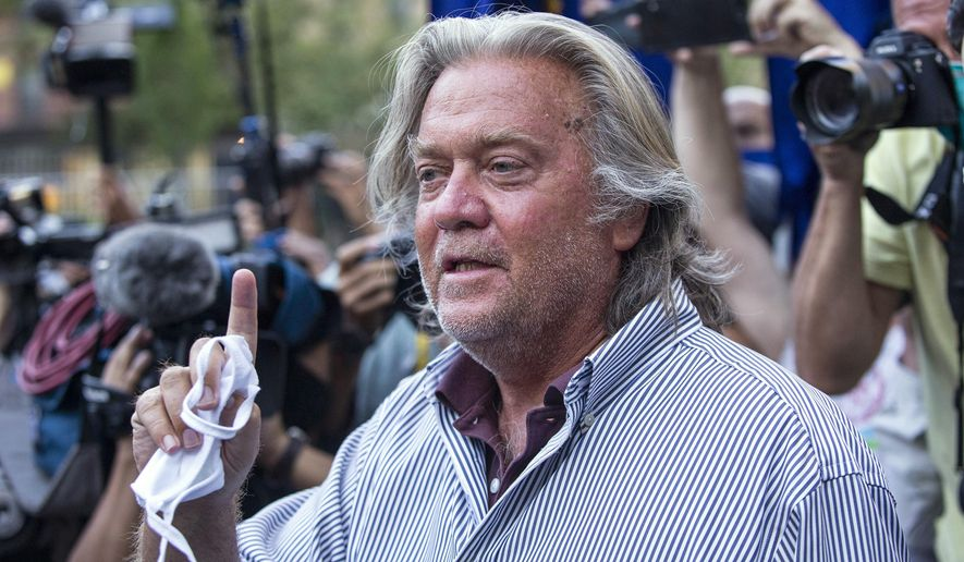 In this Aug. 20, 2020, file photo, President Donald Trump's former chief strategist, Steve Bannon, speaks with reporters in New York after pleading not guilty to charges that he ripped off donors to an online fundraising scheme to build a southern border wall. William A. Burck, a prominent Washington lawyer defending Bannon against the charges, notified a judge on Wednesday, Nov. 25, 2020, that he will no longer be representing Bannon in the case. (AP Photo/Eduardo Munoz Alvarez, File)