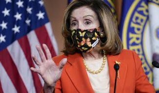 Speaker of the House Nancy Pelosi, D-Calif., holds a news conference at the Capitol in Washington, Friday, Jan. 15, 2021. (AP Photo/J. Scott Applewhite)