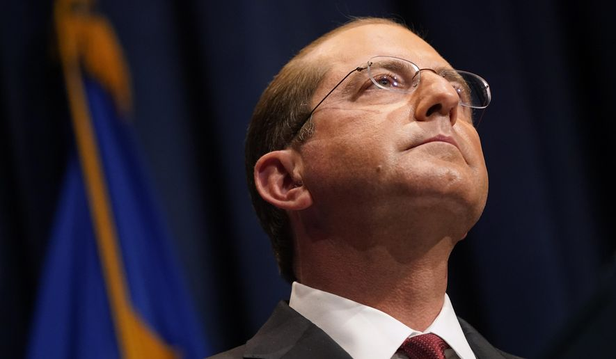 Health and Human Services Secretary Alex Azar listens to a reporter's question during a news conference on Operation Warp Speed and COVID-19 vaccine distribution, Tuesday, Jan. 12, 2021, in Washington. (AP Photo/Patrick Semansky, Pool)