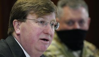 Mississippi Gov. Tate Reeves announces that residents who are 65 and older and those with preexisting conditions will now be eligible to receive the coronavirus vaccine during a press conference in Jackson, Miss., Tuesday, Jan. 12, 2021. (AP Photo/Rogelio V. Solis)