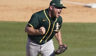 FILE - Oakland Athletics pitcher Liam Hendriks reacts after striking out Houston Astros' Josh Reddick during the eighth inning of Game 3 of a baseball American League Division Series in Los Angeles, in this Wednesday, Oct. 7, 2020, file photo. The Chicago White Sox have finalized a $54 million, three-year deal with Oakland Athletics closer Liam Hendriks, another big move as they set their sights on a championship run. The deal was announced Friday, Jan. 15, 2021. (AP Photo/Marcio Jose Sanchez)