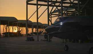 """FILE - In this April 24, 2019, file photo released by the U.S. Air Force, an F-35A Lightning II fighter jet prepares to taxi and take off from Al-Dhafra Air Base in the United Arab Emirates, on April 24, 2019. The United States called Bahrain and the United Arab Emirates """"major security partners"""" early Saturday, Jan. 16, 2021, a previously unheard of designation for the two countries home to major American military operations. (Staff Sgt. Chris Drzazgowski/U.S. Air Force via AP)"""