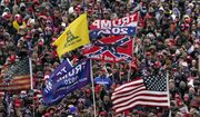 In this Wednesday, Jan. 6, 2021, file photo, supporters listen as President Donald Trump speaks as a Confederate-themed and other flags flutter in the wind during a rally in Washington. (AP Photo/Evan Vucci, File)