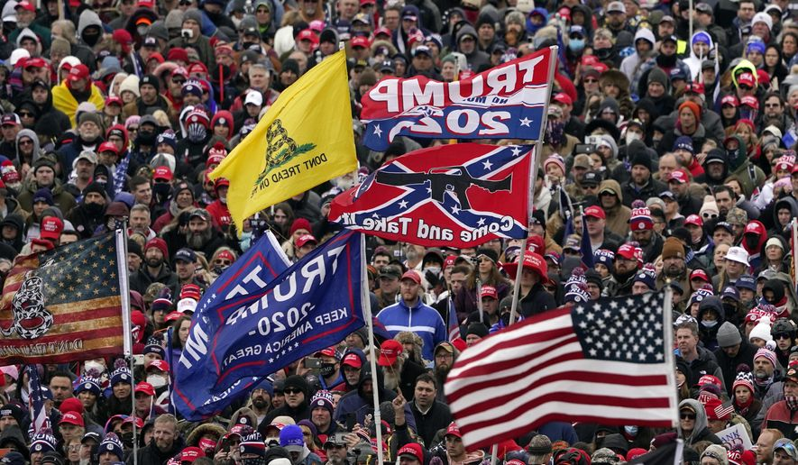 In this Wednesday, Jan. 6, 2021, file photo, supporters listen as President Donald Trump speaks as a Confederate-themed and other flags flutter in the wind during a rally in Washington. War-like imagery has begun to take hold in mainstream Republican political circles in the wake of the deadly attack on the U.S. Capitol, with some elected officials and party leaders rejecting calls to tone down their rhetoric contemplating a second civil war. (AP Photo/Evan Vucci, File)  **FILE**