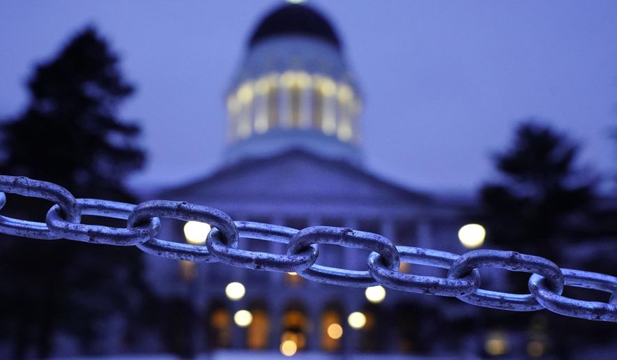 A chain blocks the sidewalk entrance to the front steps of the Maine State House, Wednesday, Jan. 13, 2021, in Augusta, Maine. With the FBI warning of potential violence at all state capitols Sunday, Jan. 17, the ornate halls of government and symbols of democracy looked more like heavily guarded U.S. embassies in war-torn countries.    (AP Photo/Robert F. Bukaty)