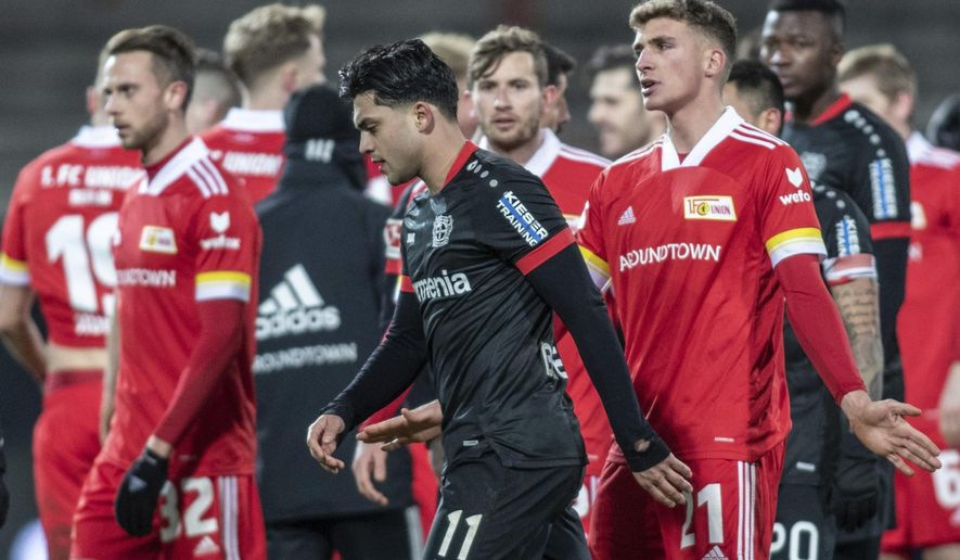 Nadiem Amiri of Bayer Leverkusen moves away  during the German Bundesliga soccer match against Union Berlin in Berlin, Germany, Friday, Jan. 15, 2021.Bayer Leverkusen midfielder Nadiem Amiri says he has accepted an apology from a Union Berlin player for personal verbal abuse after their Bundesliga game on Friday.  (Andreas Gora/Pool via AP)