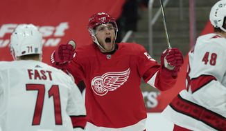 Detroit Red Wings right wing Bobby Ryan celebrates his goal against the Carolina Hurricanes in the second period of an NHL hockey game Saturday, Jan. 16, 2021, in Detroit. (AP Photo/Paul Sancya)