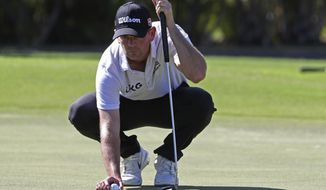 Brendan Steele lines up his putt on the ninth green during the third round at the Sony Open golf tournament Saturday, Jan. 16, 2021, in Honolulu. (AP Photo/Marco Garcia)