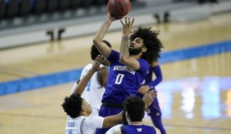 Washington guard Marcus Tsohonis (0) takes a shot against UCLA guard Jaylen Clark (0) during the first half of an NCAA college basketball game Saturday, Jan. 16, 2021, in Los Angeles. (AP Photo/Ashley Landis)