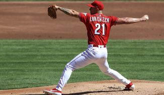 Cincinnati Reds' Michael Lorenzen throws in the second inning during a baseball game against the Chicago White Sox in Cincinnati, Sunday, Sept. 20, 2020. (AP Photo/Aaron Doster)