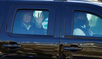 President Trump, while taking golf escapes from a city he felt was a prison, would get heckled by D.C. residents. (Associated Press/File)