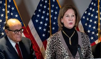 'Elite strike force team' Sidney Powell and Rudolph W. Giuliani said, among other things, that part of the Nov. 3 presidential ballots were counted overseas using Dominion Voting Systems. They claimed to have found a communist money trail that flowed from Europe to Venezuela. (Associated Press photographs)