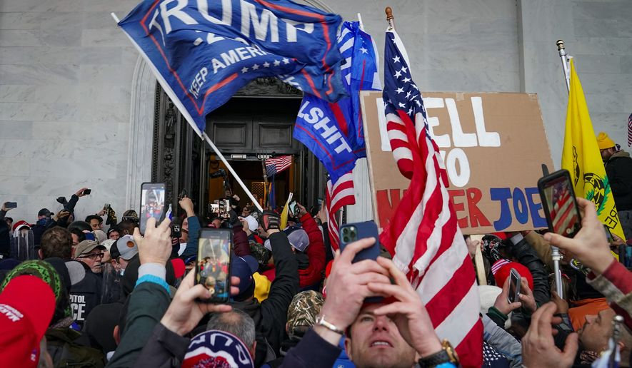 "President Trump's critics say the impetus for the Jan. 6 attack on the Capitol was his repeated claim that Democrats ""stole"" the election. Allies note that he told a rally crowd beforehand to march ""peacefully and patriotically make your voices heard."" (Associated Press)"